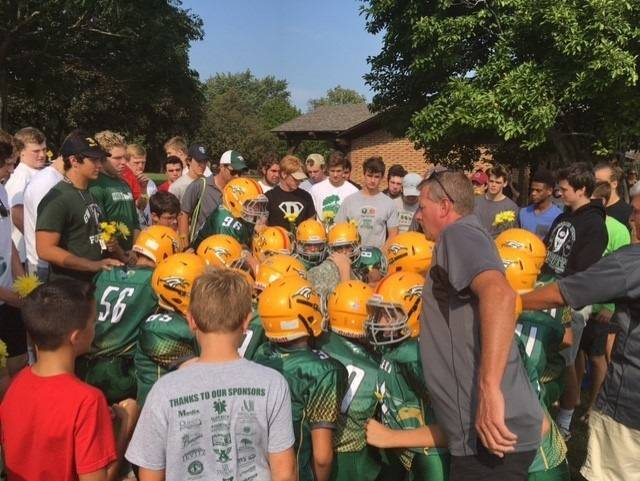 Community service a way of life for Glenbard West football team