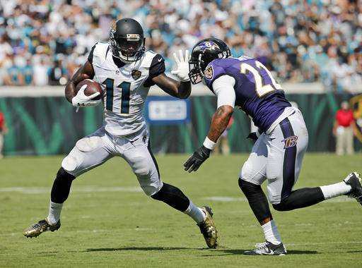 Jacksonville Jaguars wide receiver Marqise Lee (11) makes a move to get past Baltimore Ravens cornerback Jimmy Smith (22) during the second half of an NFL football game in Jacksonville, Fla., Sunday, Sept. 25, 2016. (AP Photo/Stephen B. Morton)