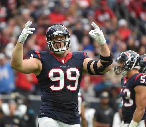 FILE - In this Jan. 3, 2016, file photo, Houston Texans defensive end J.J. Watt (99) gestures during the first half of an NFL football game against the Jacksonville Jaguars, in Houston. A person familiar with J.J. Watt's condition says he has re-injured his back and the Houston Texans expect him to be out until at least December, and possibly the entire season, Tuesday, Sept. 27, 2016. (AP Photo/Eric Christian Smith, File)