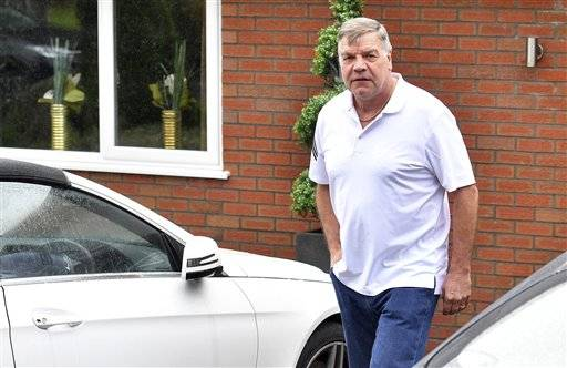 Former England soccer team manager Sam Allardyce leaves his home in Bolton, England Wednesday Sept. 28, 2016. Even by English soccer's standards, the latest embarrassment is a new low after Sam Allardyce was forced out in disgrace after one game in charge of the national team. (Dave Howarth PA via AP) UNITED KINGDOM OUT