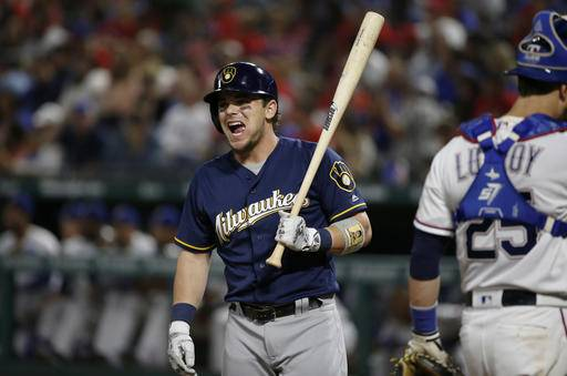 Milwaukee Brewers designated hitter Scooter Gennett reacts before later striking out during his at bat as Texas Rangers catcher Jonathan Lucroy (25) walks away during the sixth inning of a baseball game Tuesday, Sept. 27, 2016, in Arlington, Texas. The Rangers won 6-4. (AP Photo/Ron Jenkins)