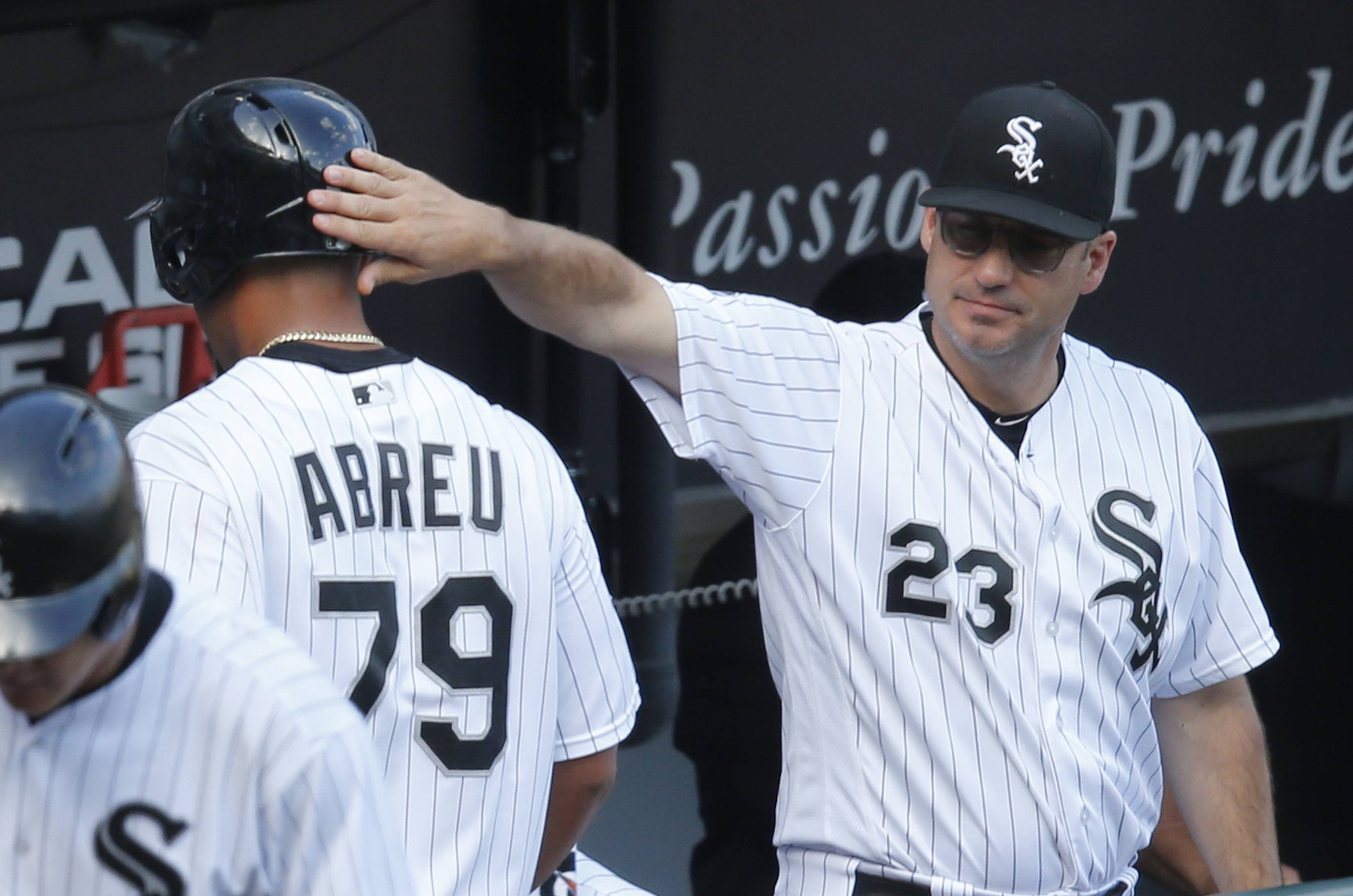 Chicago White Sox manager Robin Ventura (23) pats Jose Abreu on the helmet after Abreu scored on a double by Justin Morneau during the eight inning of a baseball game against the Detroit Tigers, Wednesday, Sept. 7, 2016, in Chicago. (AP Photo/Charles Rex Arbogast)