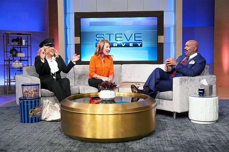 "Nancy Gianni of South Barrington, center, talks with actress Kym Whitley and host Steve Harvey about her Hoffman Estates-based GiGi's Playhouse foundation aimed at supporting families of children with Down syndrome, during Monday's episode of the ""Steve Harvey"" show."