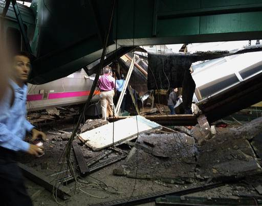 This photo provided by Ian Samuel shows the scene of a train crash in Hoboken, N.J., on Thursday, Sept. 29, 2016. A commuter train barreled into the New Jersey rail station during the Thursday morning rush hour, causing serious damage. The train came to a halt in a covered area between the station's indoor waiting area and the platform. A metal structure covering the area collapsed.