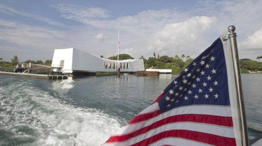 FILE - This Dec. 7, 2012 file photo shows The USS Arizona Memorial at Pearl Harbor, Hawaii. The Navy has investigated the case of a sailor who didn't salute as the national anthem played during a morning flag-raising at Pearl Harbor on Monday, Sept. 19, 2016. (AP Photo/Eugene Tanner, File)