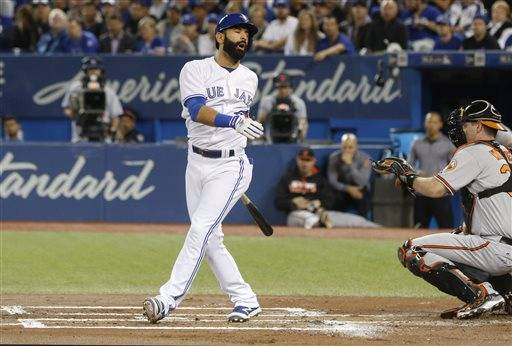 Toronto Blue Jays' Jose Bautista, left, reacts after striking out in front of Baltimore Orioles' Matt Wieters, right, during the first inning of a baseball game in Toronto, Thursday Sept. 29, 2016. (Mark Blinch/The Canadian Press via AP)