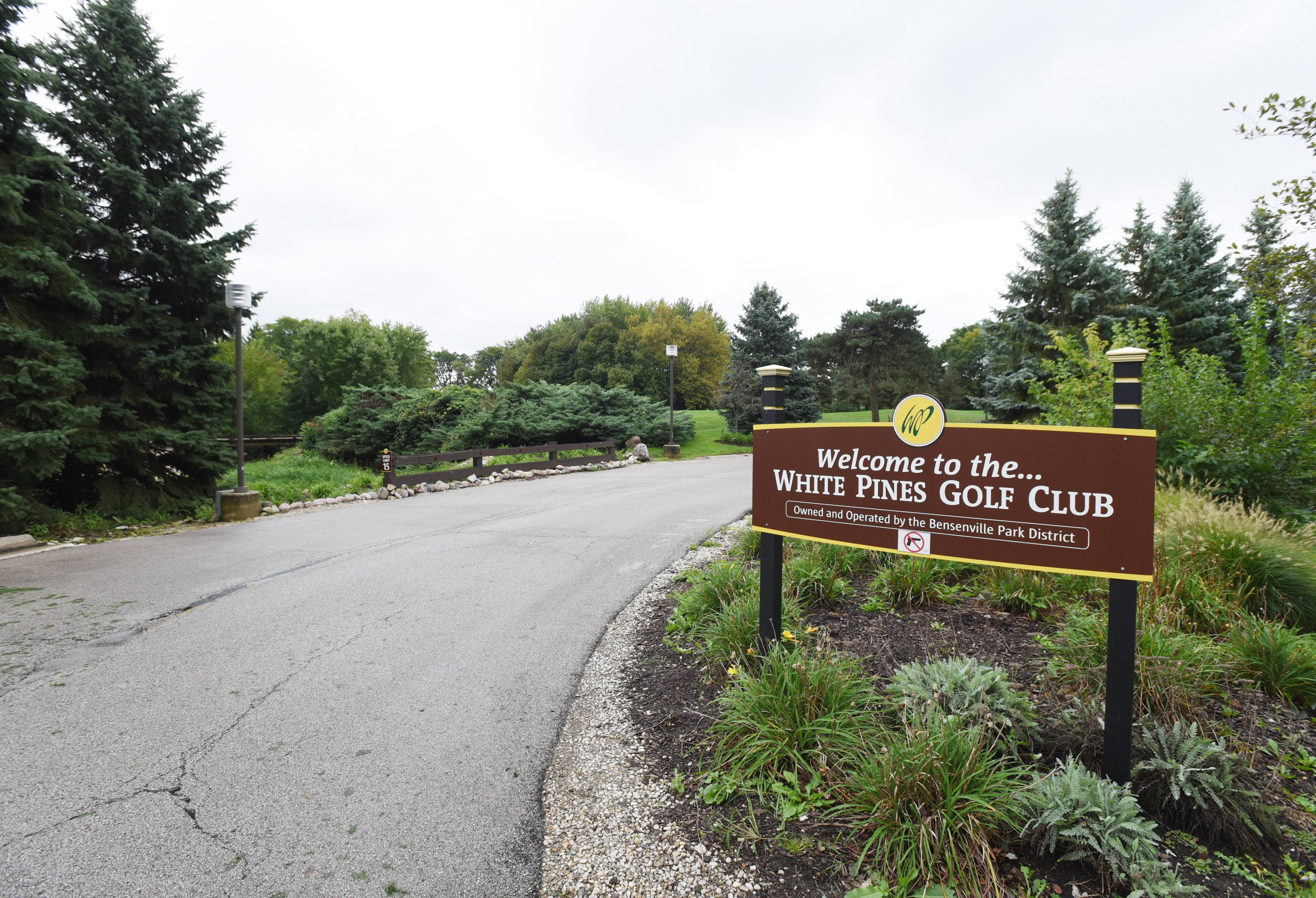 White Pines Golf Club in Bensenville reopened for business Friday, one day after a woman's body was discovered on the property.
