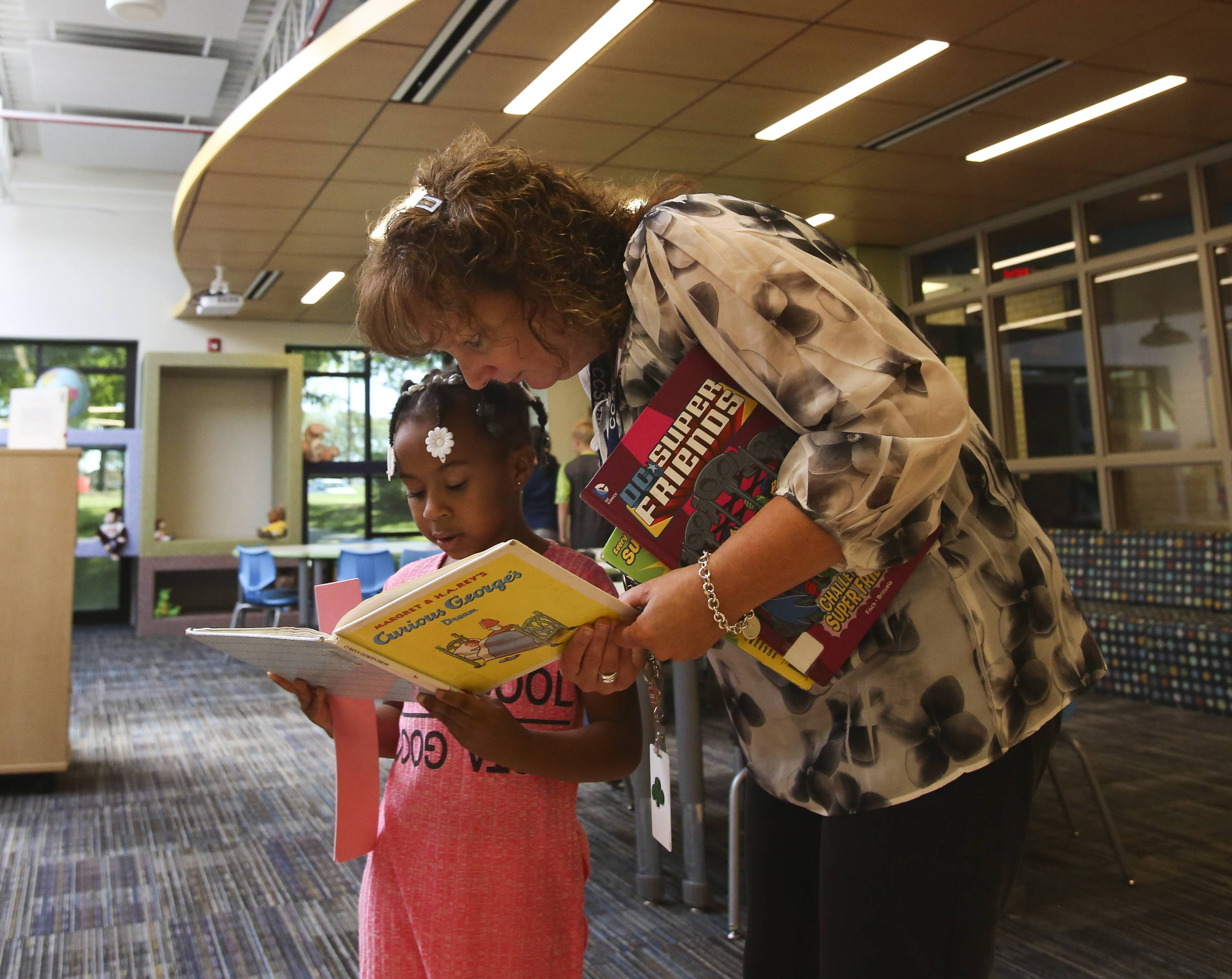 Second-grade teacher Kathy Siciliano reads alongside student J'Niaya Harris in the new Innovation Center at Roy DeShane Elementary School in Carol Stream.