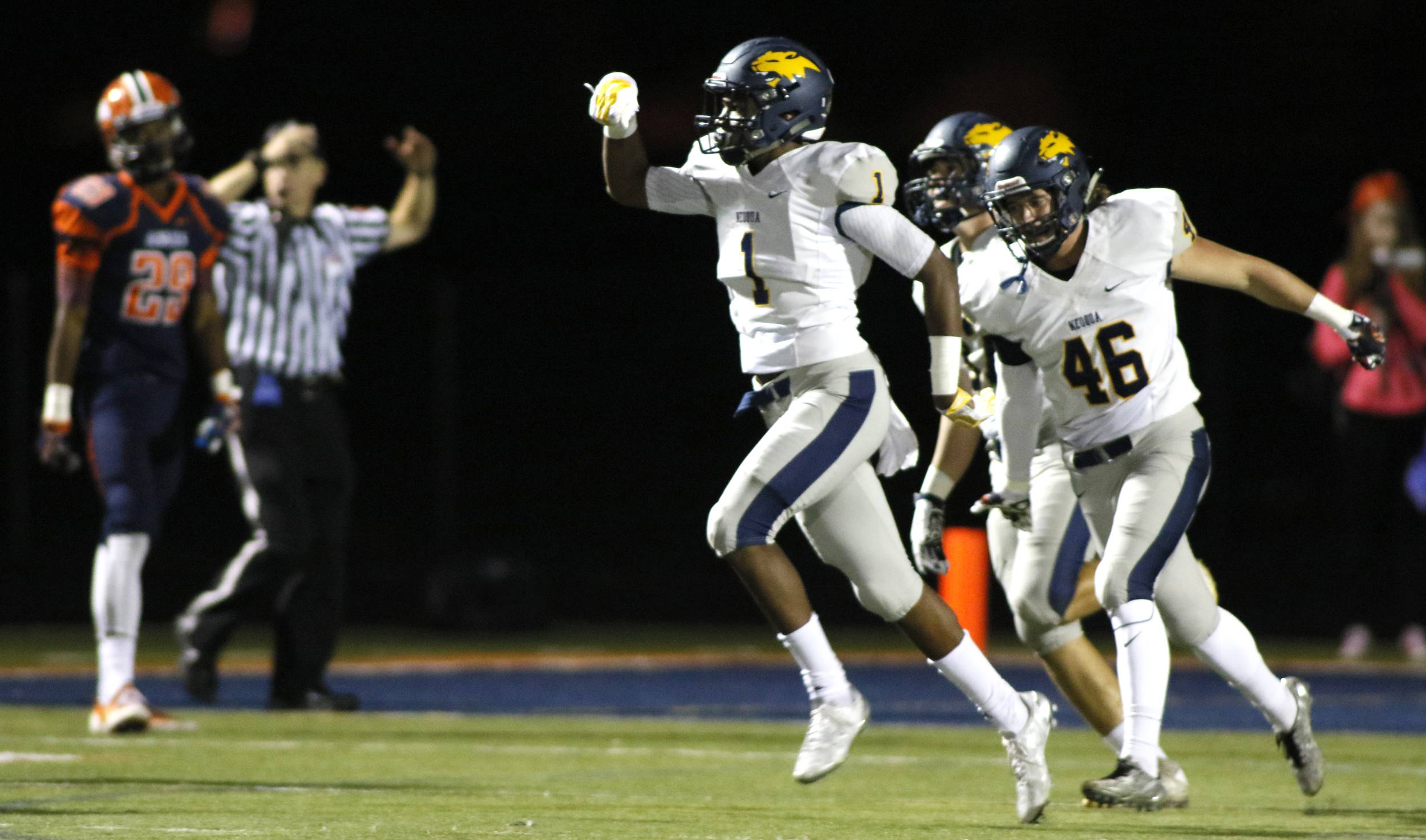 Neuqua Valley's Isaiah Robertson (1) celebrates his first-half fumble recovery which he ran back for a touchdown.