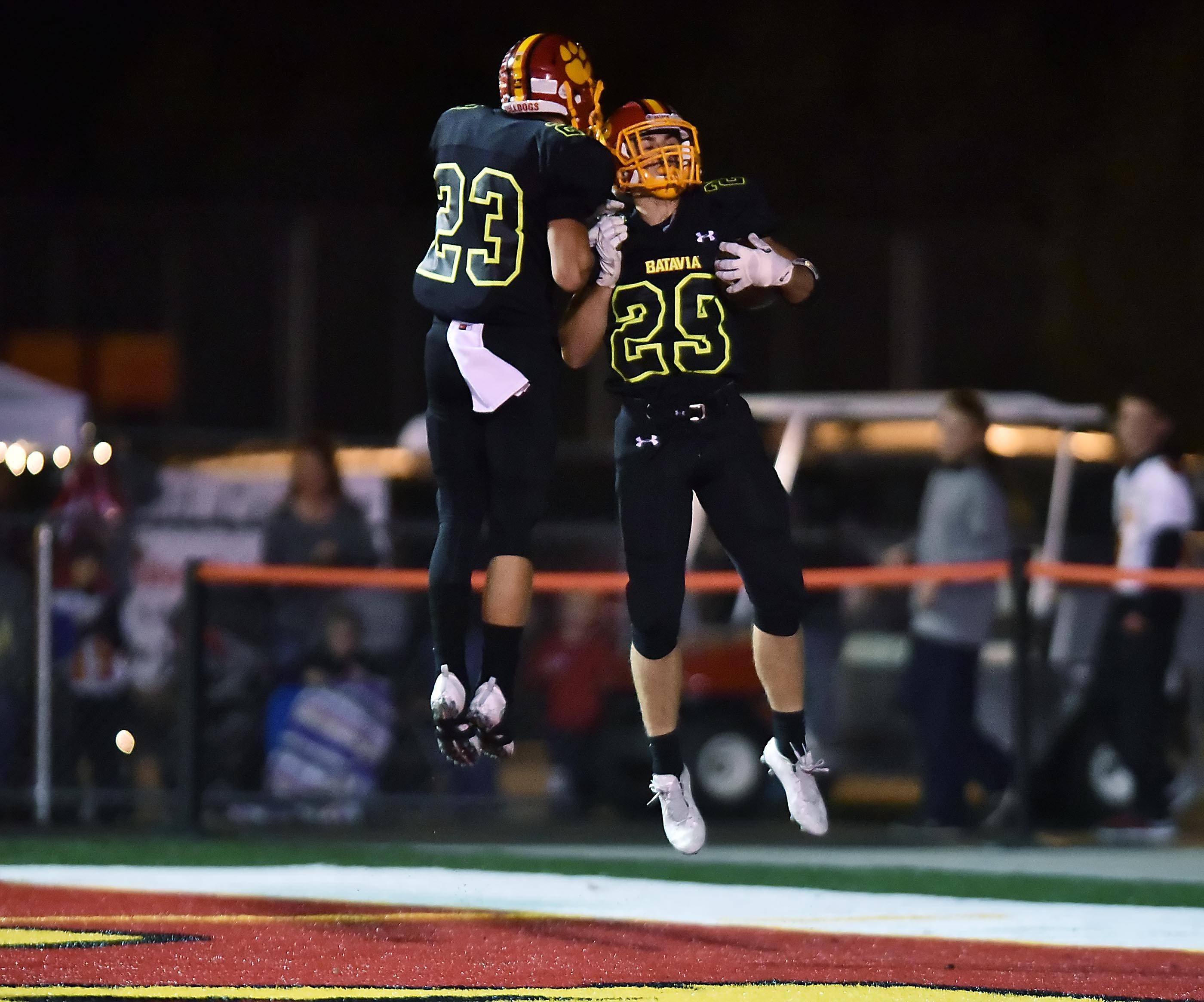 Batavia's Matthew Huizinga and teammate Thomas Stuttle celebrate Huizinga's first quarter touchdown run against Geneva at Batavia Friday night.