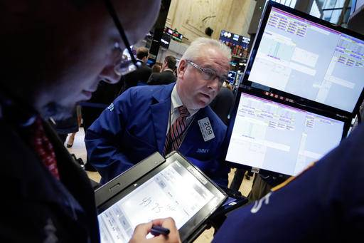 FILE - In this Monday, Sept. 26, 2016, file photo, trader James Dresch, center, works on the floor of the New York Stock Exchange. Energy stocks led most markets higher on Thursday, Sept. 29, after OPEC nations reached a preliminary deal to cut oil production for the first time in eight years. (AP Photo/Richard Drew, File)