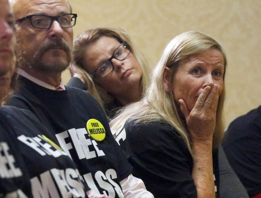 Paul and Cheryl Calusinski react Friday during a news conference after a Lake County judge refused to grant a new trial for their daughter Melissa Calusinski. She is serving a 31-year prison sentence for the murder of a toddler at a Lincolnshire day care center.