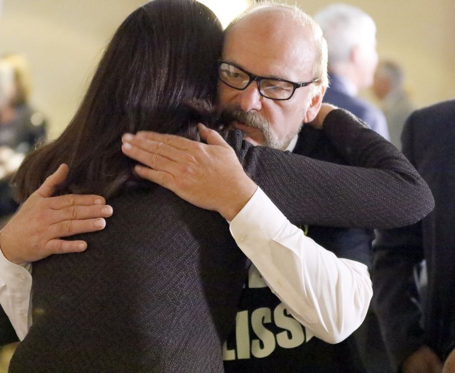 Melissa Calusinski's father, Paul, hugs defense attorney Kathleen Zellner after a news conference Friday in Waukegan. Zellner said she has drafted an appeal after a Lake County judge refused to grant a new trial in Melissa Calusinski's murder case.