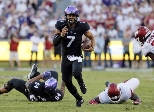 FILE - In this Sept. 10, 2016, file photo, TCU quarterback Kenny Hill (7) scrambles out of the pocket to run the ball against Arkansas during an NCAA college football game in Fort Worth, Texas. TCU faces Oklahoma this week in a Big 12 game. (AP Photo/Tony Gutierrez, File)
