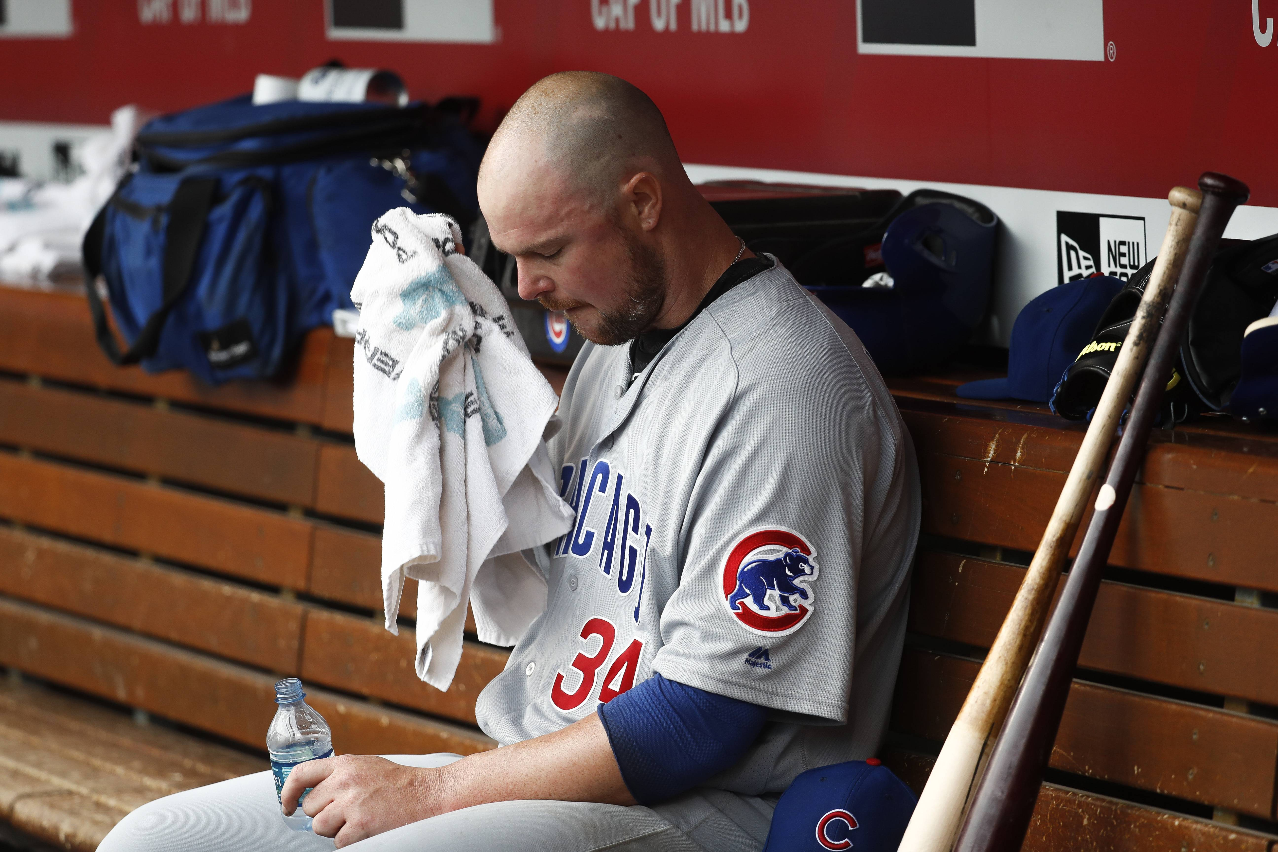 Chicago Cubs starting pitcher Jon Lester sits in the dugout after closing the third inning of a baseball game against the Cincinnati Reds, Saturday, Oct. 1, 2016, in Cincinnati. (AP Photo/John Minchillo)