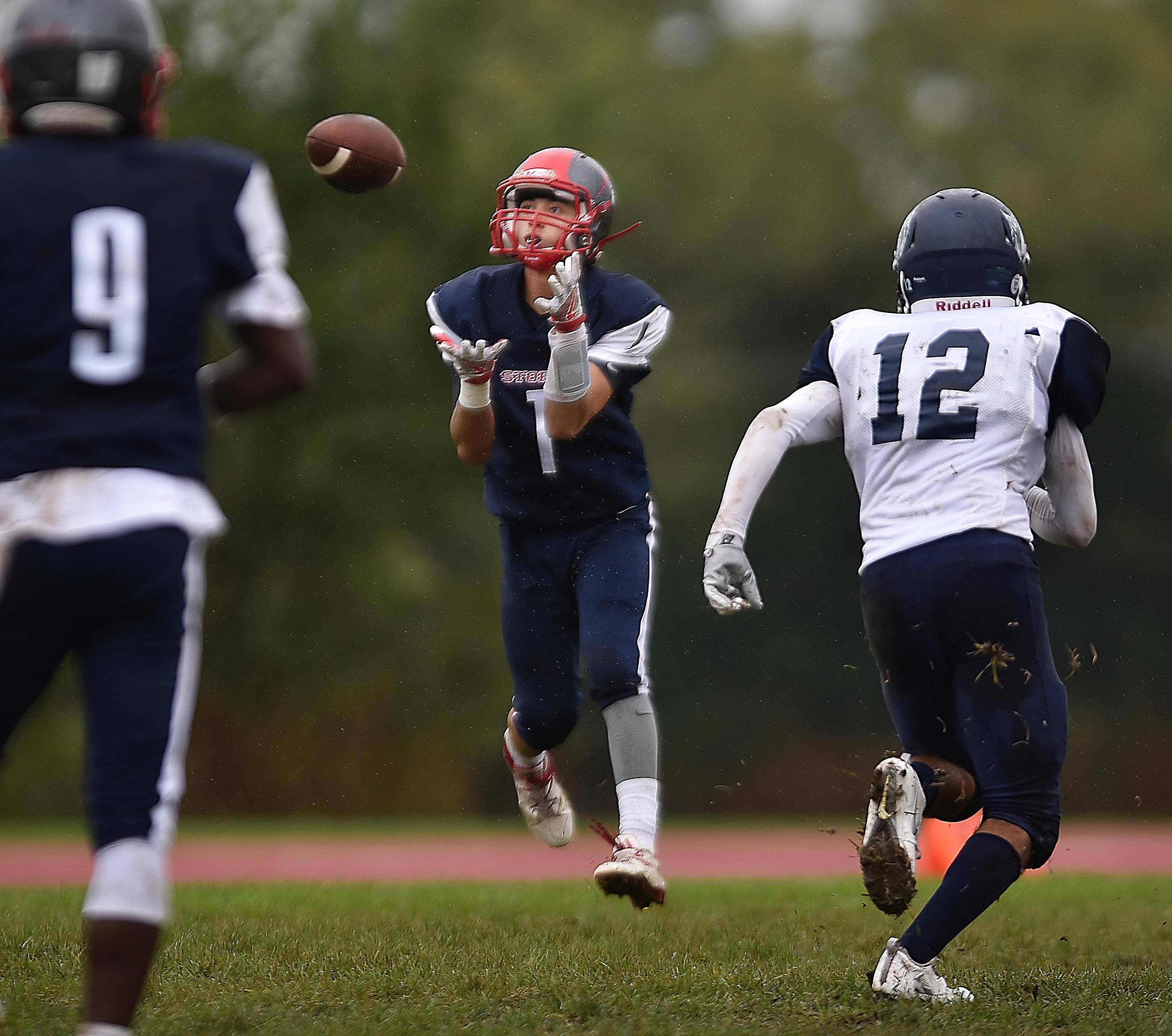 South Elgin's Azxavier Salinas catches a long touchdown pass in the second quarter against West Chicago Saturday in South Elgin.