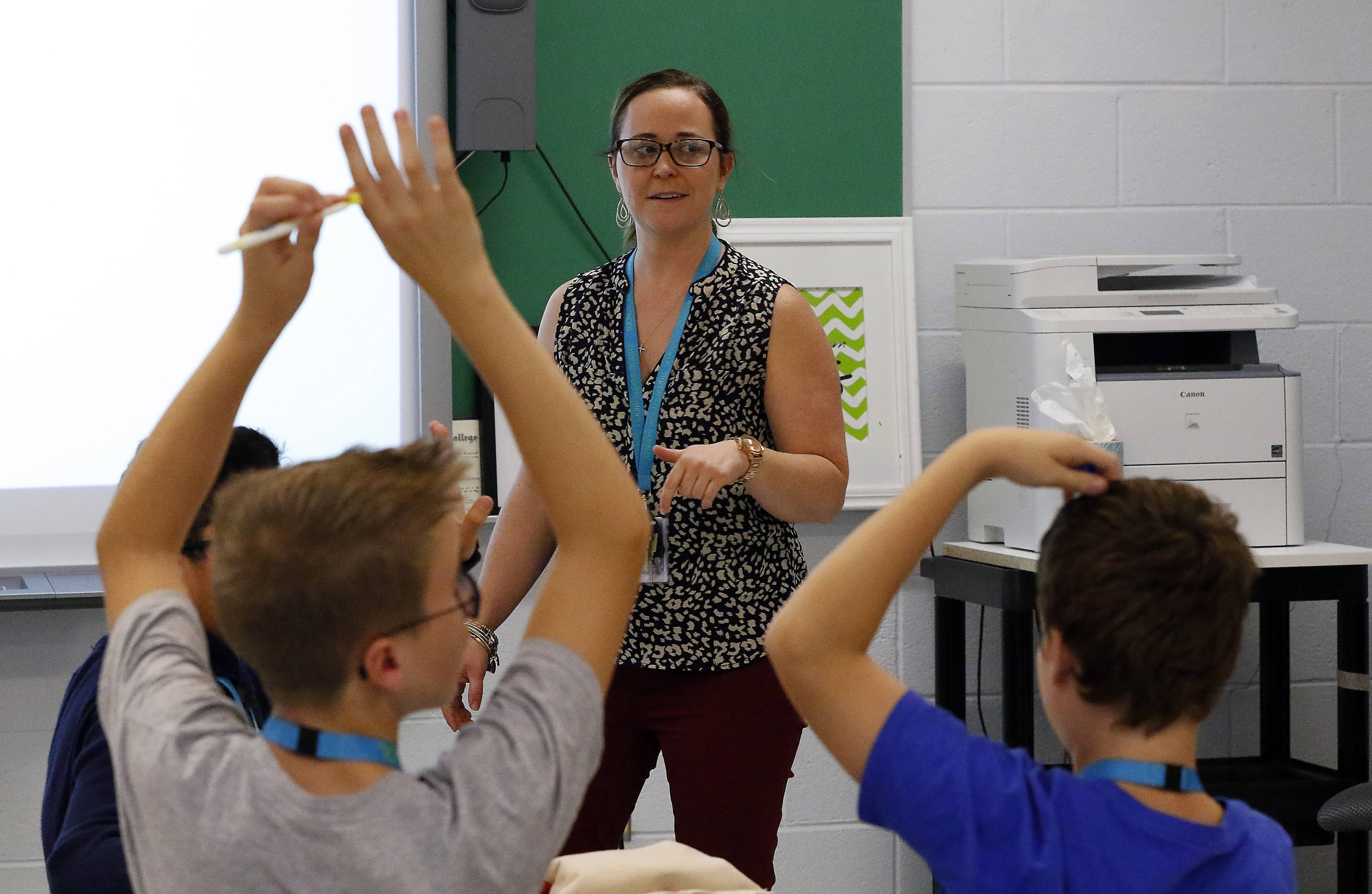 Math teacher Megan Cammack, who teaches seventh-graders at Kenyon Woods Middle School in South Elgin, employs a flip classroom method with students watching YouTube videos of her lessons beforehand and then explaining what they learned during class.