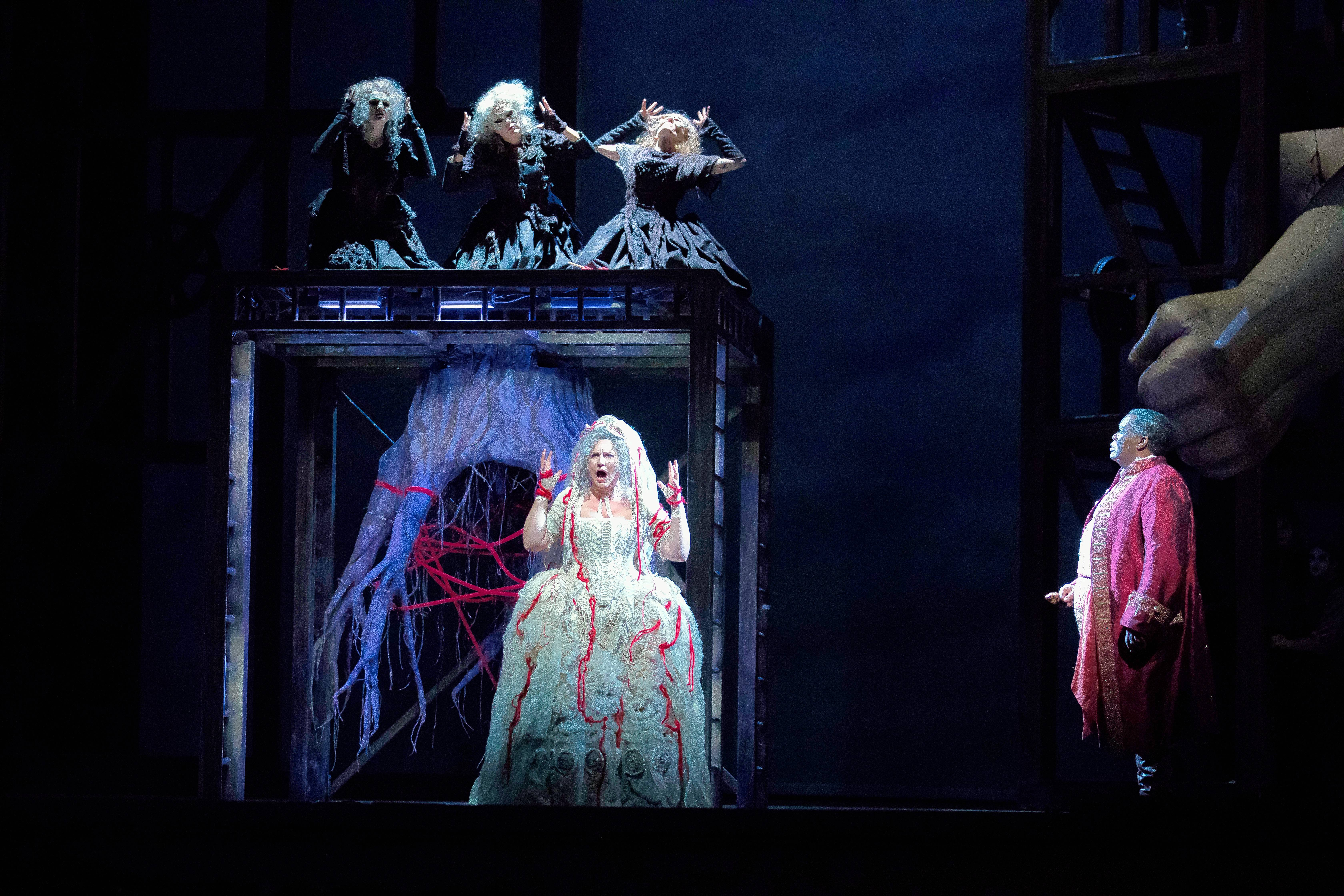 "The earth goddess Erda (German mezzo-soprano Okka von der Damerau) is summoned by the three Norns to warn Wotan (American bass-baritone Eric Owens) about Alberich's curse on the stolen ring in the Lyric Opera Chicago's new production of Richard Wagner's ""Das Rheingold."""
