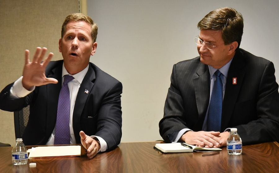 Republican 10th House District candidate Bob Dold, left, makes a point Wednesday during an interview at the Daily Herald headquarters while Democratic challenger Brad Schneider listens.
