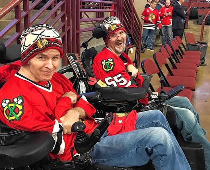 Longtime Blackhawks fans and brothers Brad, left, and Phil, both clients at Marklund in Geneva, got tickets from the Chicago team to attend the Oct. 4 game against the Detroit Red Wings.