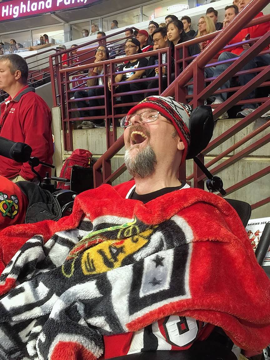 Marklund client Phil cheers on the Chicago Blackhawks during the Oct. 4 game against the Detroit Red Wings.