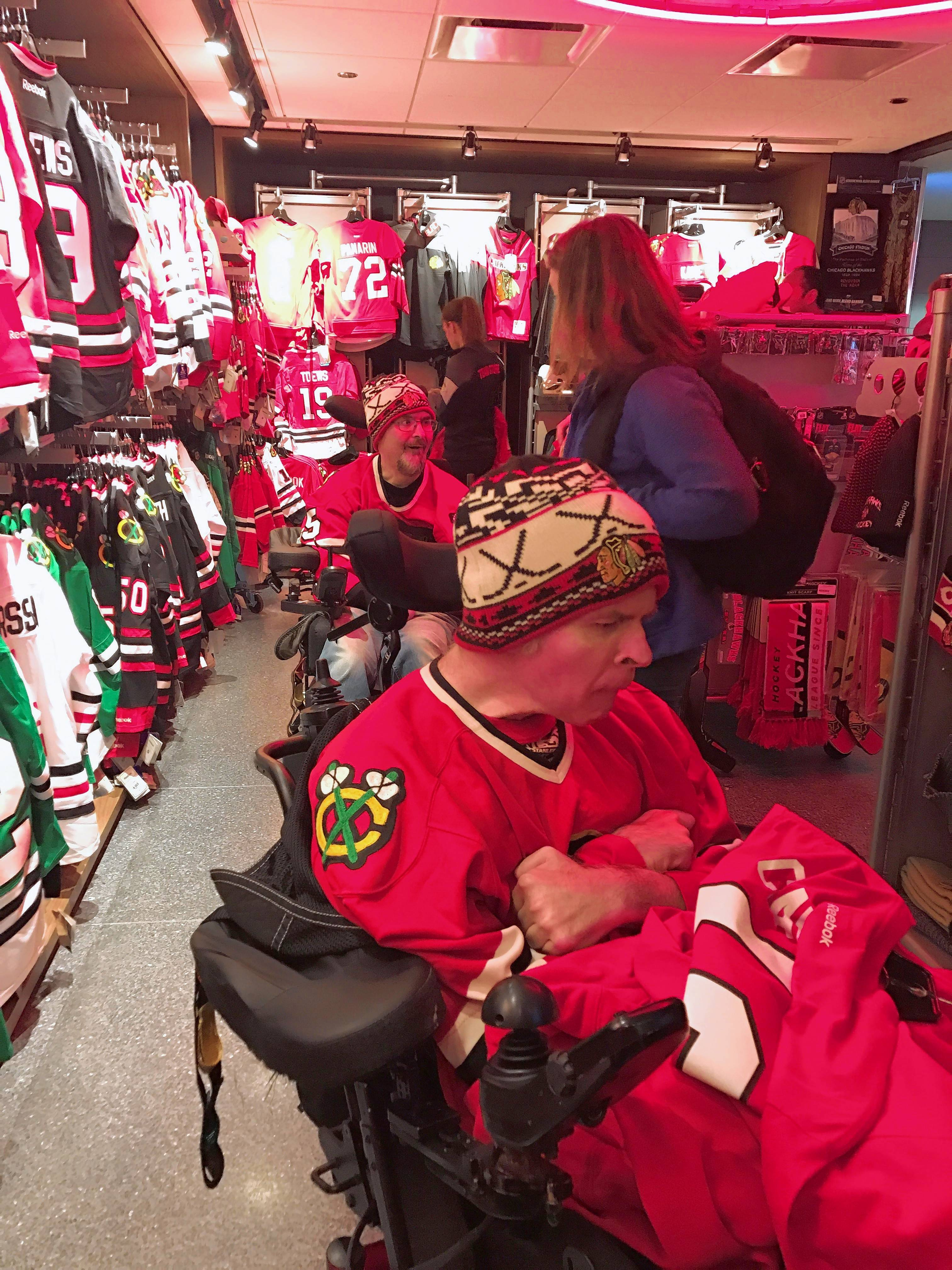 Marklund client and brothers Brad and Phil check out the selection of sports jerseys during the Oct. 4 Chicago Blackhawks game.