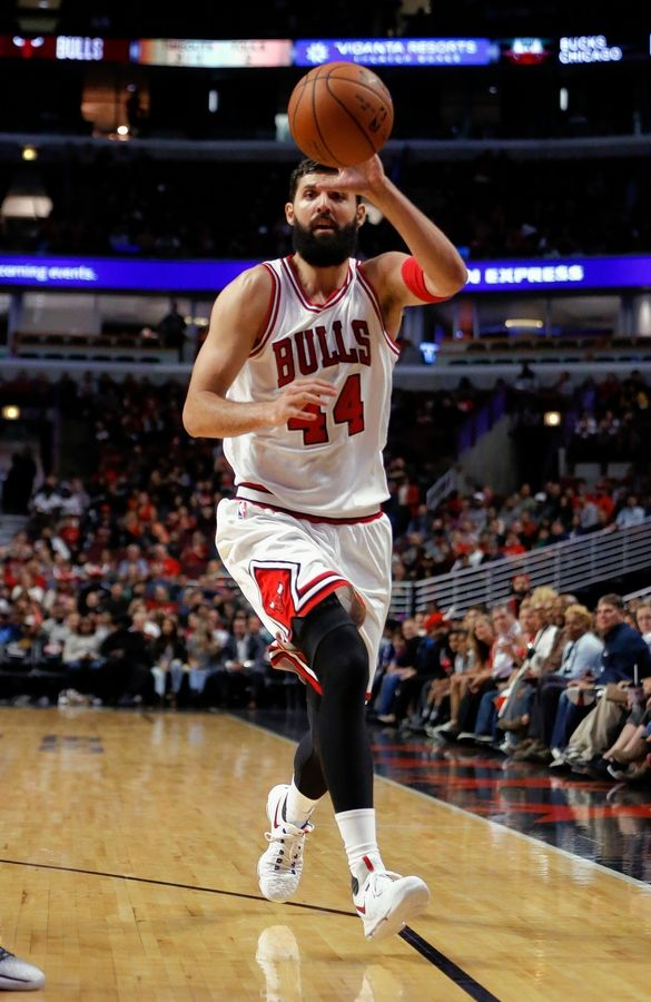 Chicago Bulls forward Nikola Mirotic receives a pass during the second half of an NBA preseason basketball game against the Milwaukee Bucks Monday, Oct. 3, 2016, in Chicago.