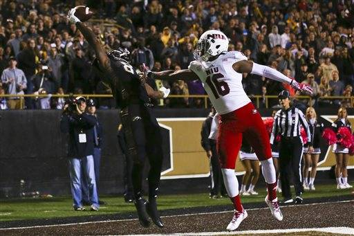 Western Michigan wide receiver Corey Davis (84) catches a pass with one hand in the end zone to score a touchdown during an NCAA college football game against Northern Illinois, Saturday, Oct. 8, 2016, in Kalamazoo, Mich. (Chelsea Purgahn/Kalamazoo Gazette-MLive Media Group via AP)