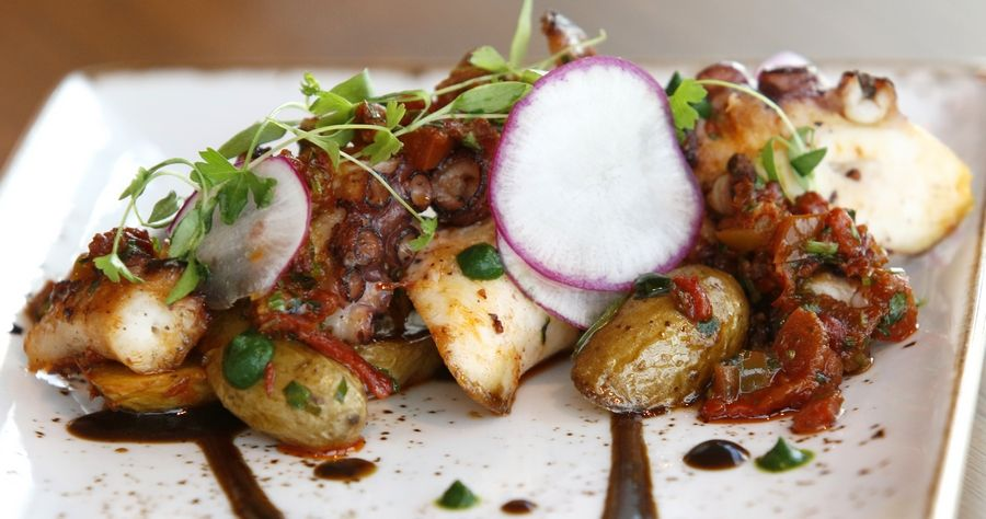 Word-of-mouth has made pulpo -- charred octopus, harissa, fingerling potatoes, tarragon and black pepper sauce -- one of the most popular tapas dishes at El Tapeo, according to executive chef Matthew Cappellini.