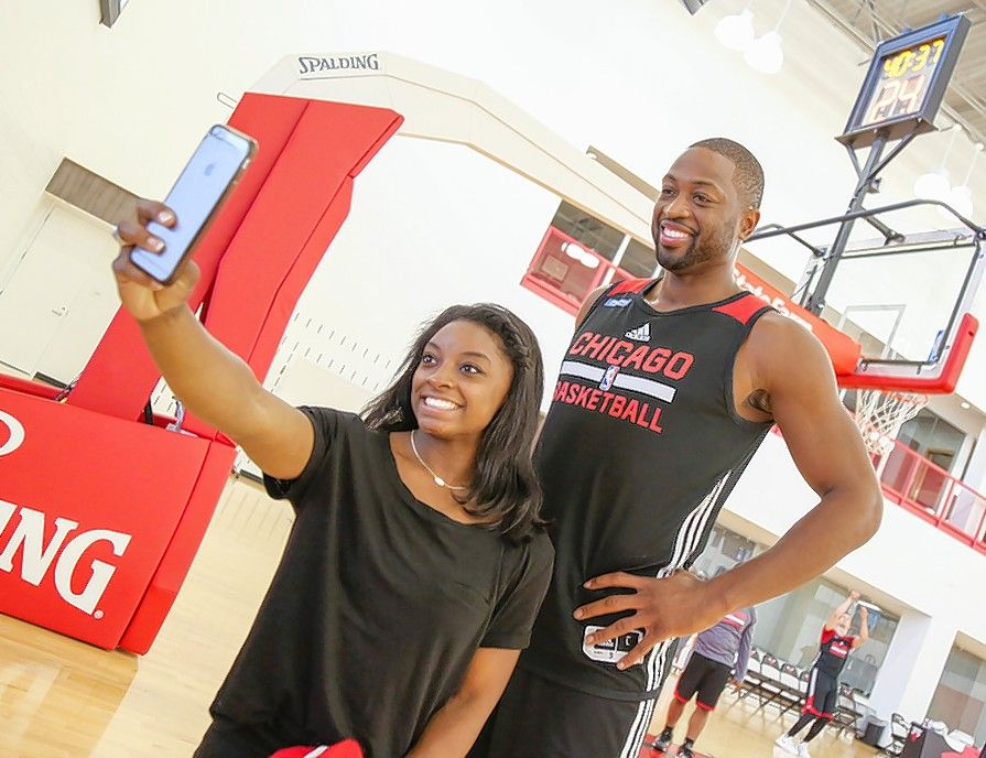 Photo courtesy of Grace Wiley/Chicago BullsOlympic gymnastics gold medalist Simone Biles was in Chicago on Wednesday and stopped by the Chicago Bulls training facility, where she took a selfie with Dywane Wade and many other players.