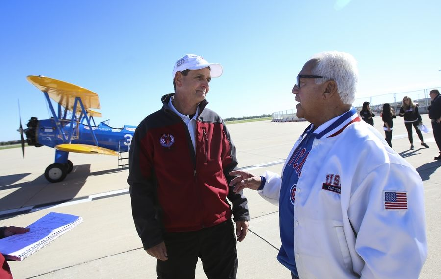 Volunteer pilot Tim Newton talks with World War II veteran Dom Errichiello, 91, before their flight in a Stearman biplane at the DuPage Airport in West Chicago. Errichiello was among a group of veterans from the Windsor Park retirement community in Carol Stream who were given free rides Thursday.