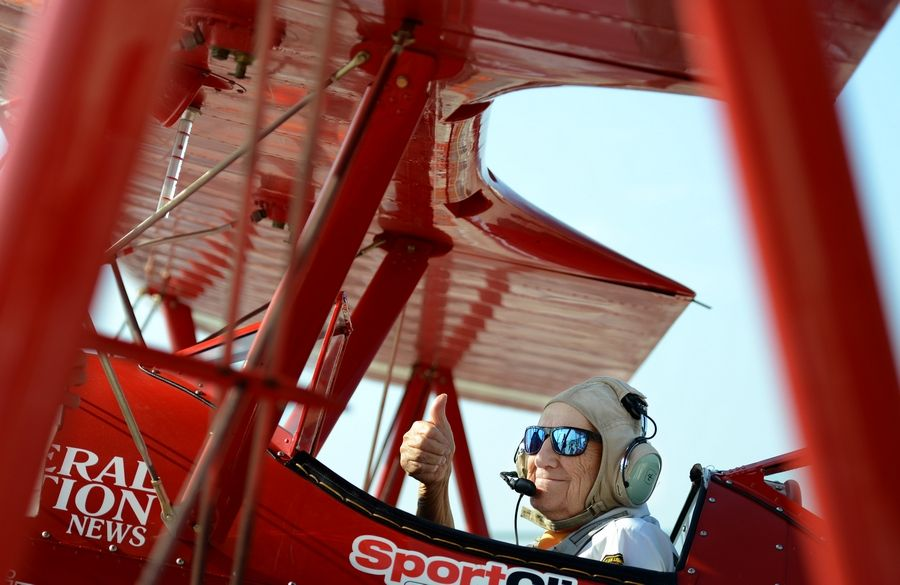 John Faust gives a thumbs-up before takeoff at the DuPage Airport. Faust was among several veterans from The Holmstad retirement community in Batavia who got a chance to fly last month in a World War II-era biplane.