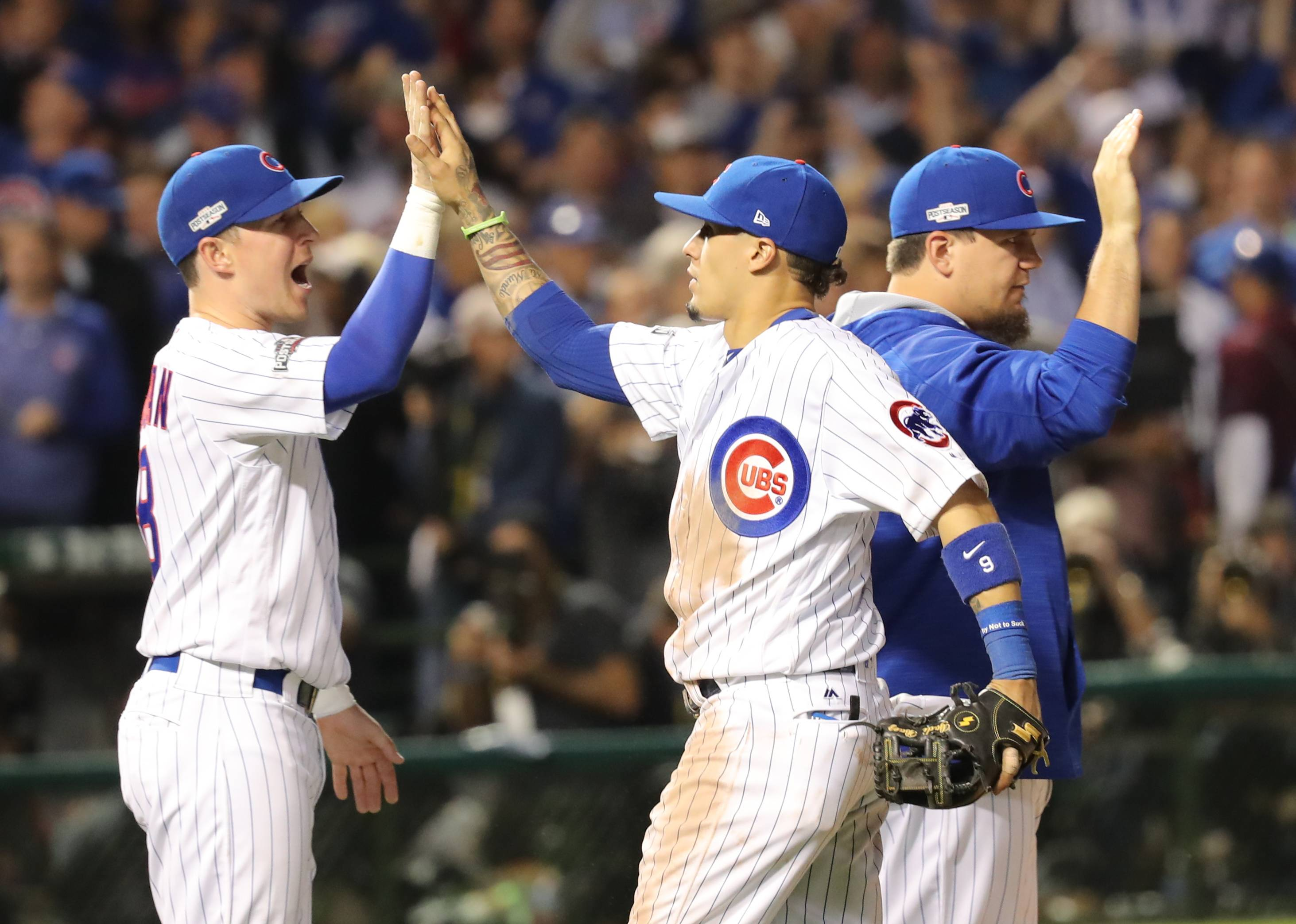 Chicago Cubs Chris Coghlan and Chicago Cubs Javier Baez celebrate after their win during game 1 of the National League championship series against the Los Angeles Dodgers at Wrigley Field in Chicago on Saturday, October, 15, 2016.
