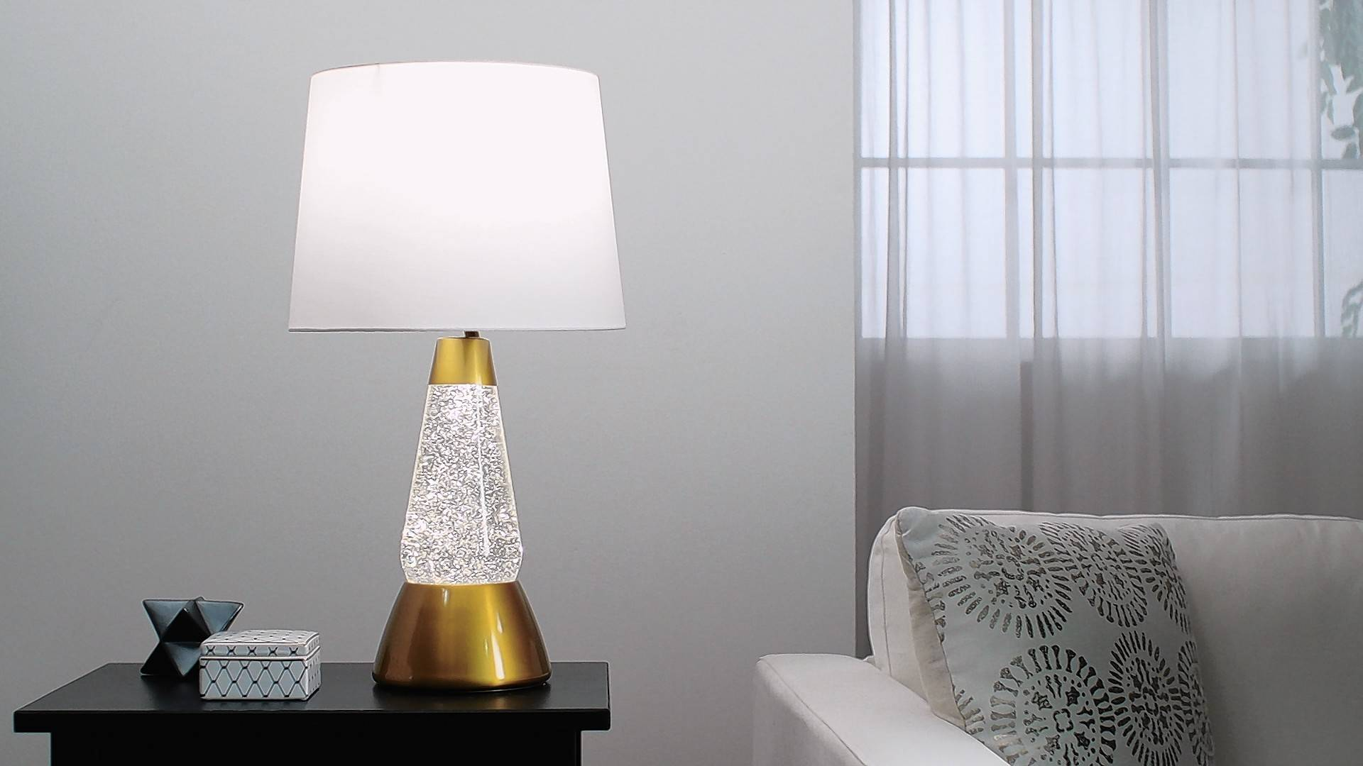 Bright Source lamps come in four styles, including one with a gold base and silver glitter.