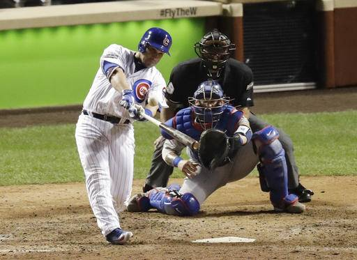 Chicago Cubs' Miguel Montero (47) hits a grand slam during the eighth inning of Game 1 of the National League baseball championship series against the Los Angeles Dodgers Saturday, Oct. 15, 2016, in Chicago.