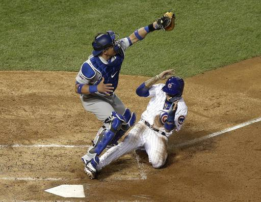 Chicago Cubs' Javier Baez steals home against Los Angeles Dodgers catcher Carlos Ruiz (51) during the second inning of Game 1 of the National League baseball championship series Saturday, Oct. 15, 2016, in Chicago.
