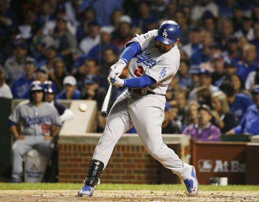 Los Angeles Dodgers' Adrian Gonzalez hits a single during the first inning of Game 1 of the National League baseball championship series against the Chicago Cubs Saturday, Oct. 15, 2016, in Chicago.