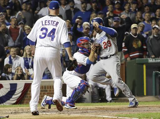 Los Angeles Dodgers' Adrian Gonzalez (23) is tagged out by Chicago Cubs catcher David Ross during the second inning of Game 1 of the National League baseball championship series Saturday, Oct. 15, 2016, in Chicago.