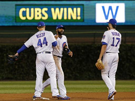 Chicago Cubs first baseman Anthony Rizzo (44), right fielder Jason Heyward (22) and third baseman Kris Bryant (17) celebrate after Game 1 of the National League baseball championship series against the Los Angeles Dodgers Saturday, Oct. 15, 2016, in Chicago. Cubs won 8-4 to take a 1-0 lead in the series.