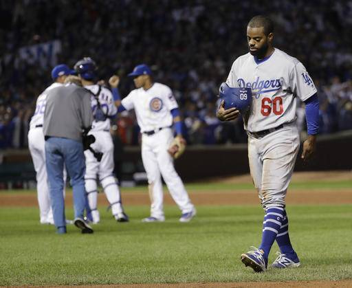 Los Angeles Dodgers' Andrew Toles (60) walks off the field after Game 1 of the National League baseball championship series against the Chicago Cubs Saturday, Oct. 15, 2016, in Chicago. Cubs won 8-4 to take a 1-0 lead in the series. Cubs won 8-4 to take a 1-0 lead in the series.