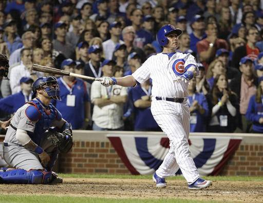 Chicago Cubs catcher Miguel Montero (47) watch the ball as he hits a grand slam during the eighth inning of Game 1 of the National League baseball championship series against the Los Angeles Dodgers Saturday, Oct. 15, 2016, in Chicago.