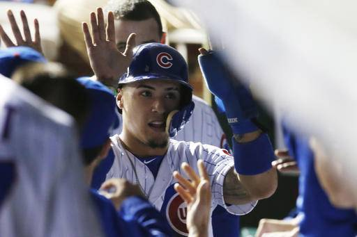 Chicago Cubs third baseman Javier Baez (9) celebrates after stealing home during the second inning of Game 1 of the National League baseball championship series against the Los Angeles Dodgers Saturday, Oct. 15, 2016, in Chicago.