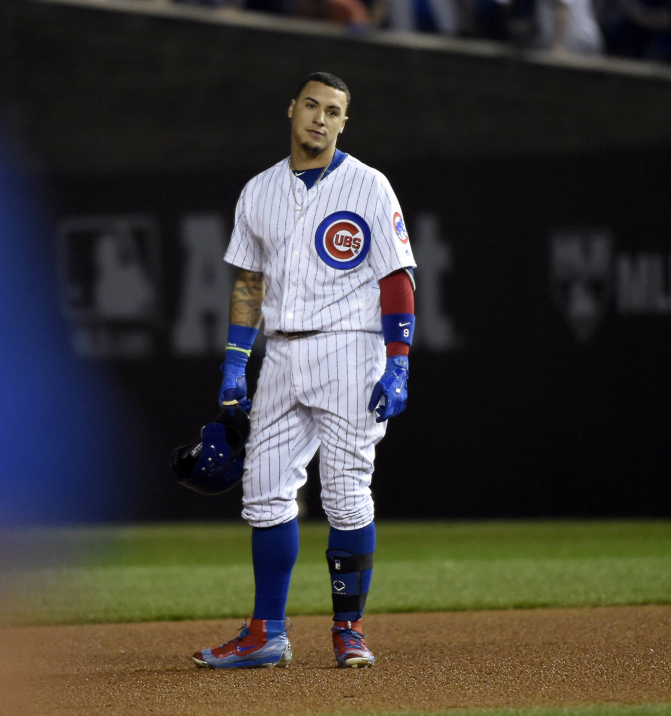 Chicago Cubs third baseman Javier Baez (9) reacts after flying out after flying out in the seventh inning during Game 2 of baseball's National League championship series against the Los Angeles Dodgers, Oct, 16 2016, at Wrigley Field in Chicago.