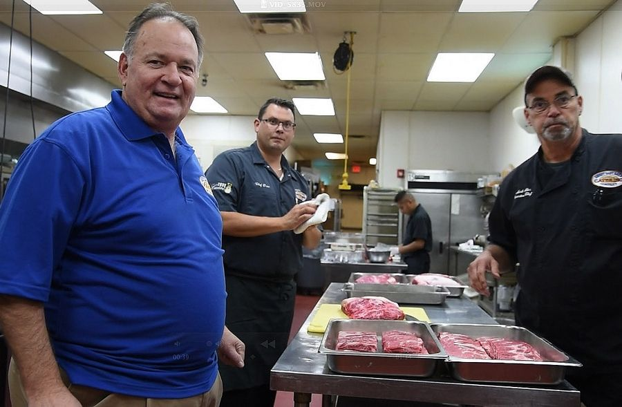 Dave Raymond of Wood Dale, and co-founder of Sweet Baby Ray's BBQ sauce, restaurants and catering business, with his nephew Duce Raymond, center, and executive chef Mark Aker, inside their catering kitchen.