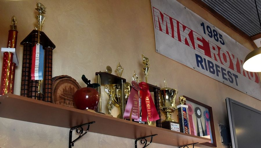 Dave Raymond of Wood Dale, and co-founder of Sweet Baby Ray's BBQ sauce, restaurants and catering business. Here are some of their awards from competition displayed inside the Wood Dale restaurant.