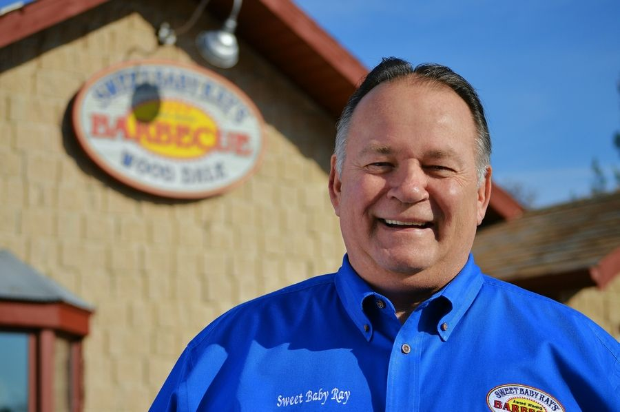 Dave Raymond, co-founder of Sweet Baby Ray's, stands outside his Wood Dale restaurant.