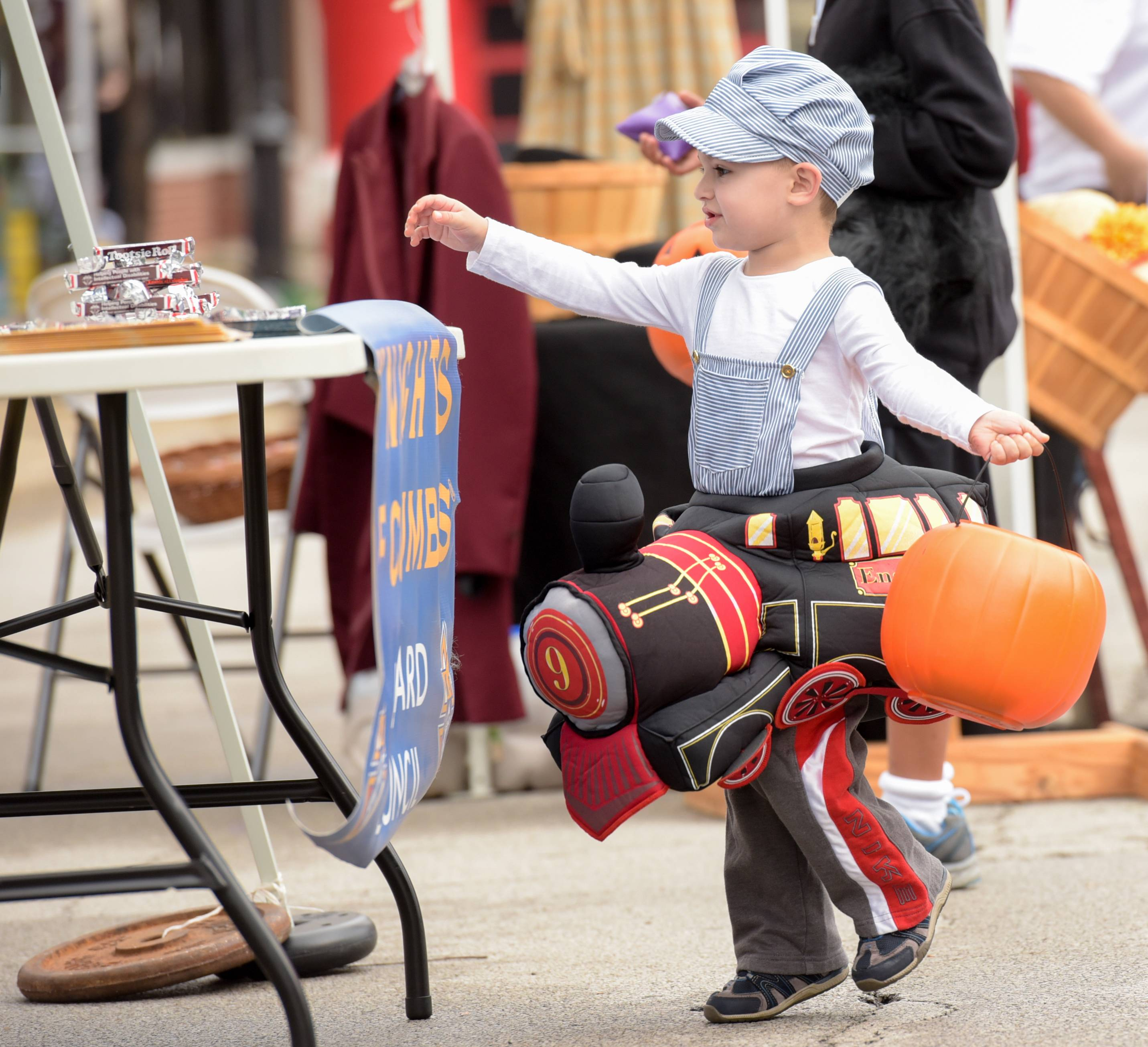 Ryker Priest, 2 of Wheaton trick or treats during the annual Lombard Town Centre's Spooktactular event in downtown Lombard.