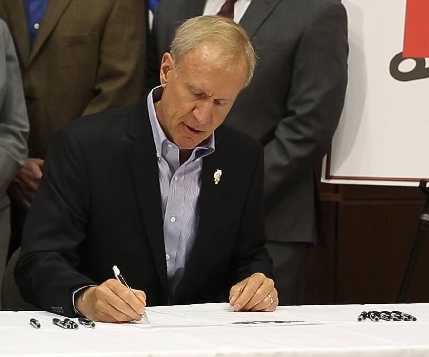 Gov. Bruce Rauner signs an executive order to review all agency rules and regulations by the newly created Illinois Competitiveness Council.