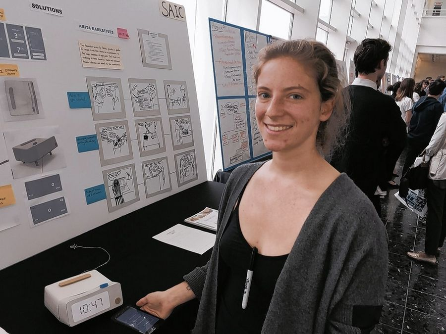 School of the Art Institute student Paige Landesberg demonstrates the Kindred at the AMITA Health Design Challenge on Sunday in Arlington Heights.