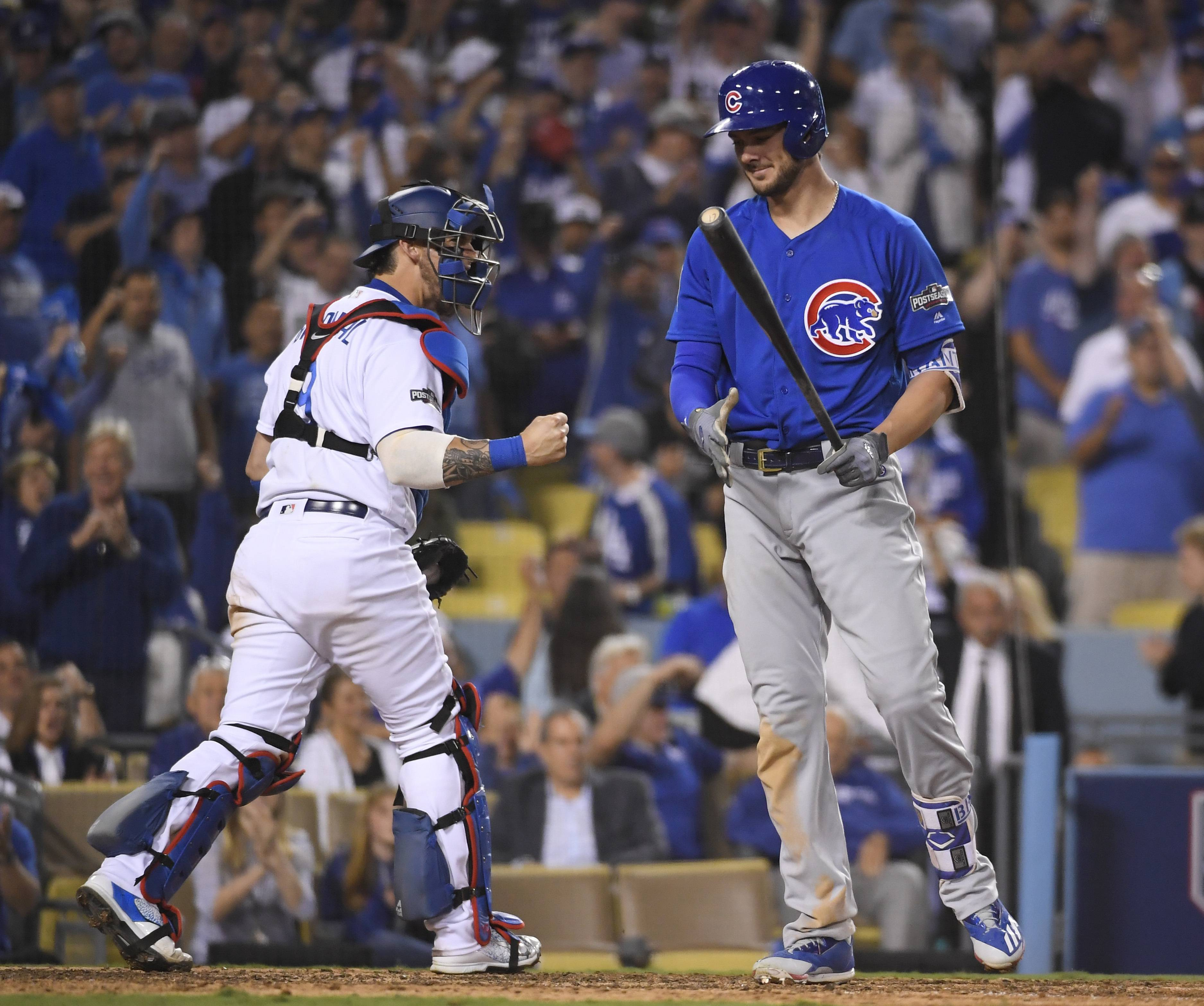 Los Angeles Dodgers catcher Yasmani Grandal reacts after Chicago Cubs' Kris Bryant strikes out during the eighth inning of Game 3 of the National League baseball championship series Tuesday, Oct. 18, 2016, in Los Angeles.